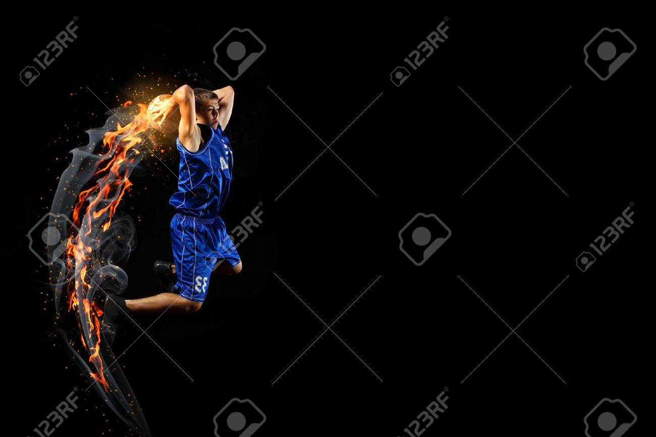 Male basketball player jumping and practicing with a ball Stock Photo - 16655158