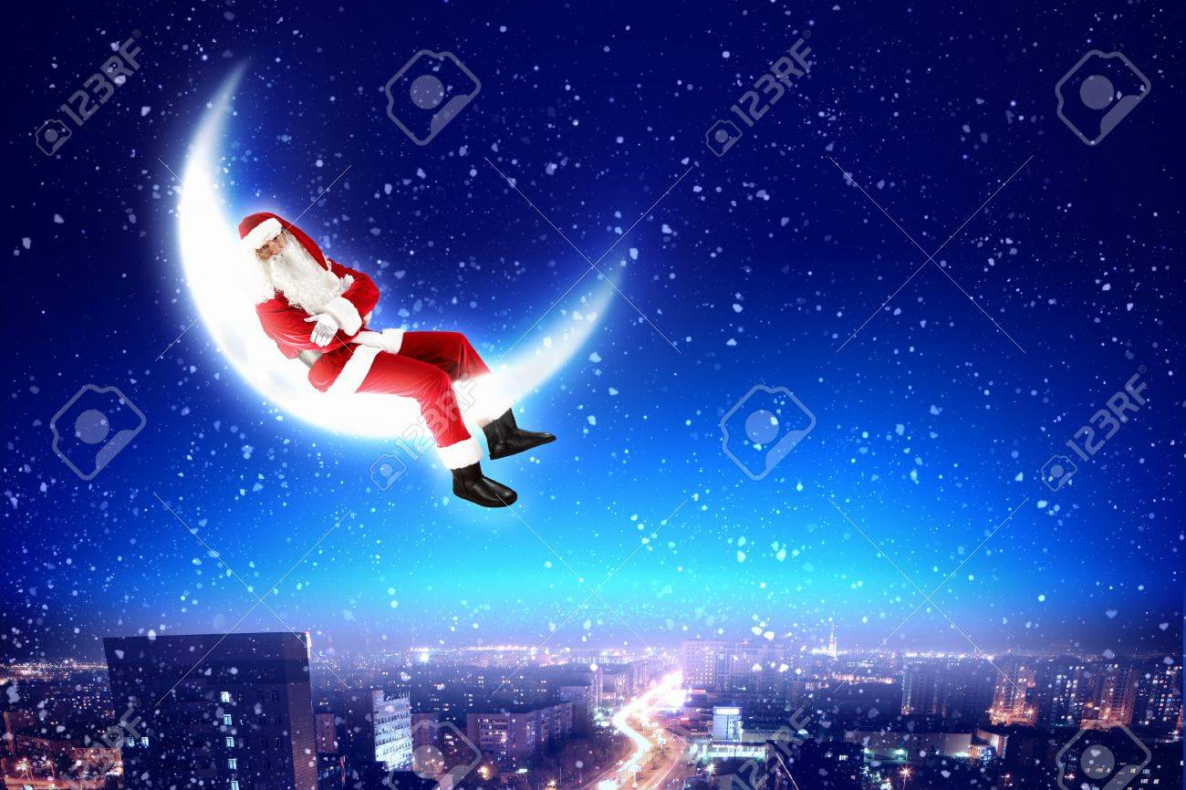 Santa Claus on the moon above a city at night Stock Photo - 16732186