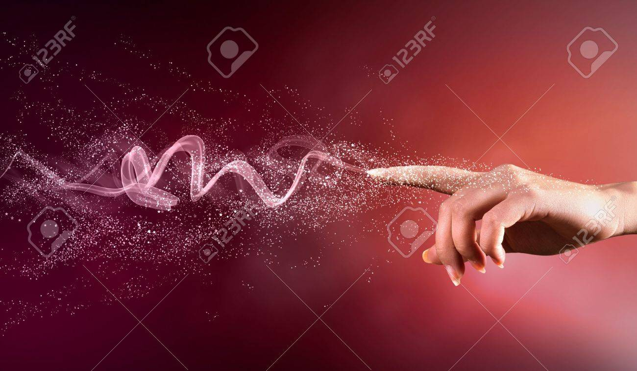 magical hand conceptual image with sparkles on colour background Stock Photo - 16648662