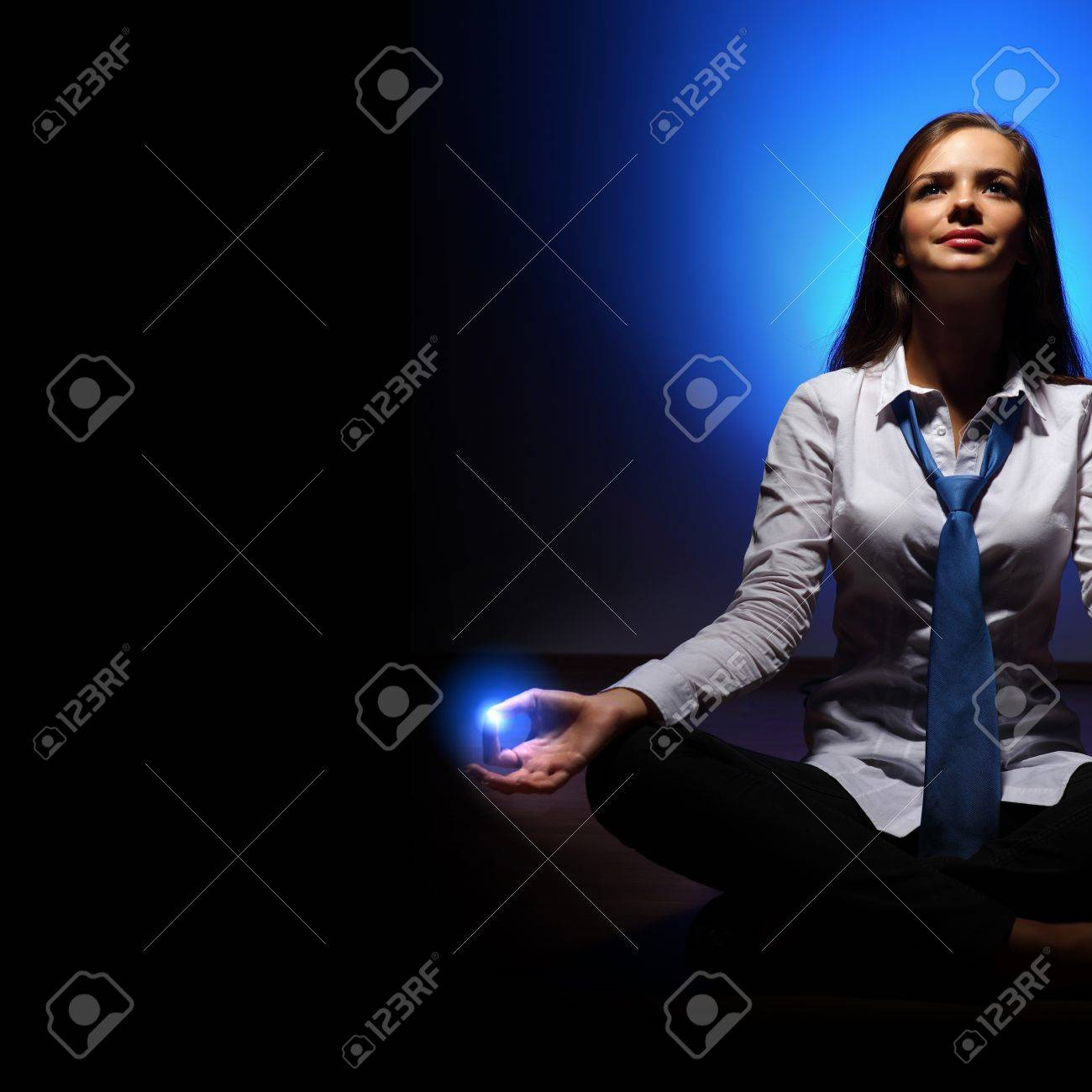 Young business woman sitting in asana lotus and meditating Stock Photo - 16716424