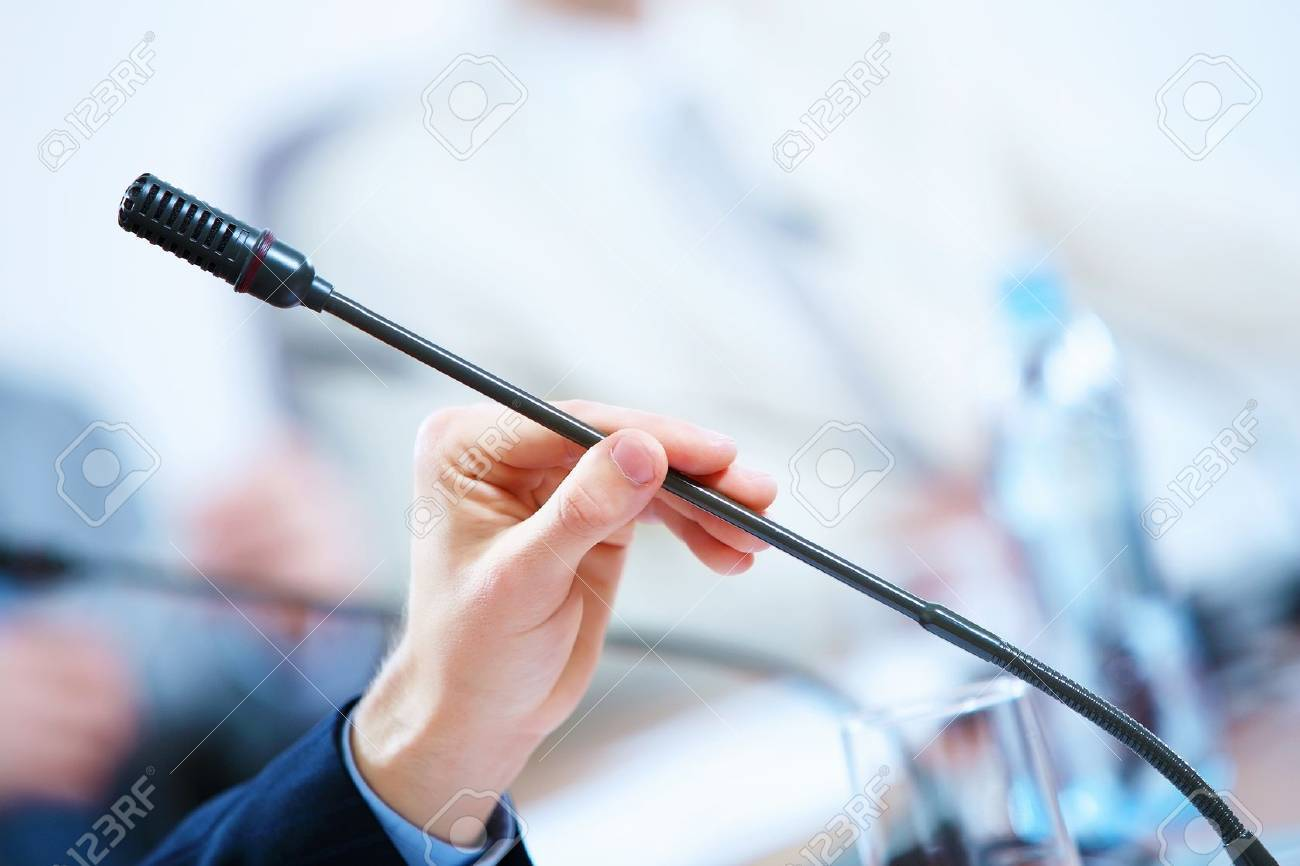 before a conference, the microphones in front of empty chairs - 16844818