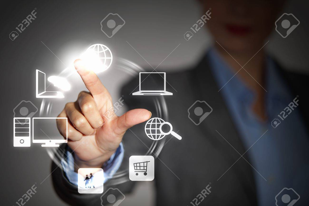 Business person pushing symbols on a touch screen interface Stock Photo - 16865973