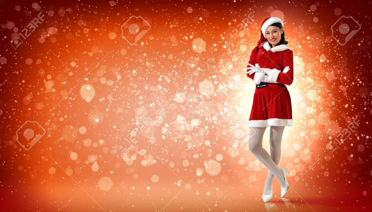 Portrait of beautiful young woman wearing santa claus clothes Stock Photo - 16866293