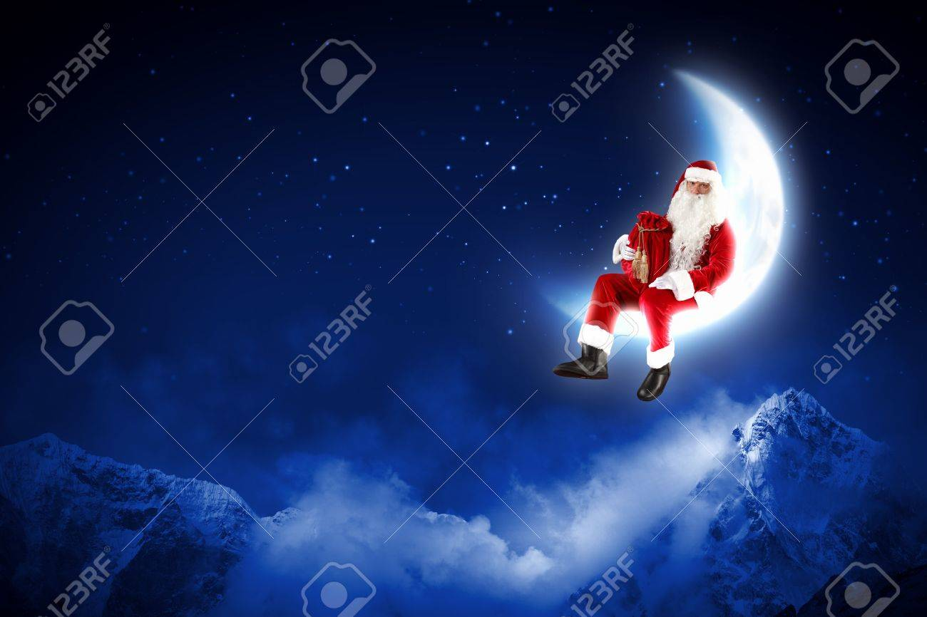 Photo of Santa Claus sitting on shiny moon above winter forest Stock Photo - 16884693