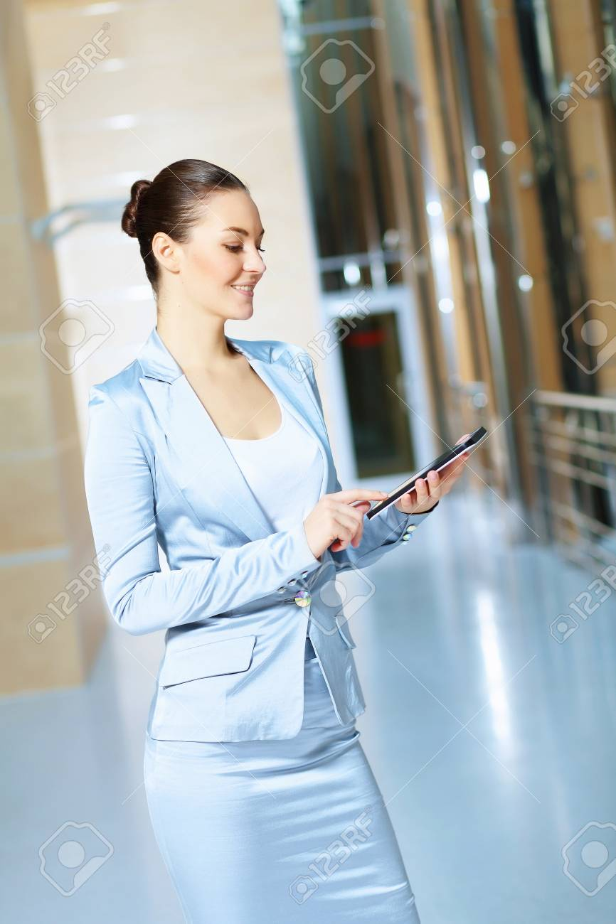Portrait of happy smiling young businesswoman in office Stock Photo - 16951287