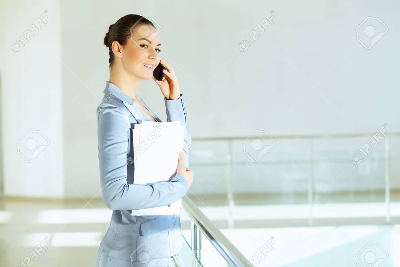 Portrait of happy smiling young businesswoman in office Stock Photo - 16951345