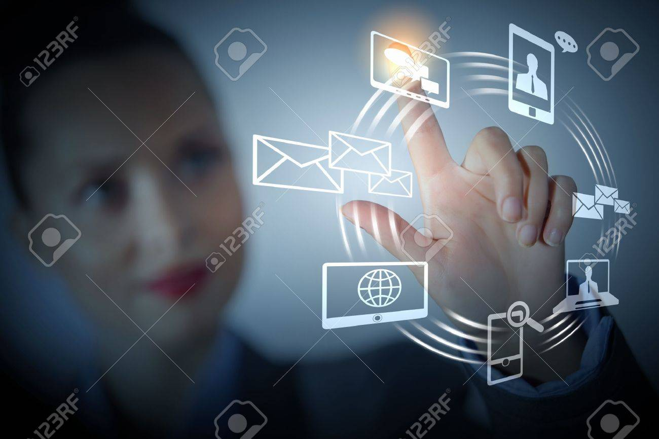 Business person pushing symbols on a touch screen interface Stock Photo - 16960119