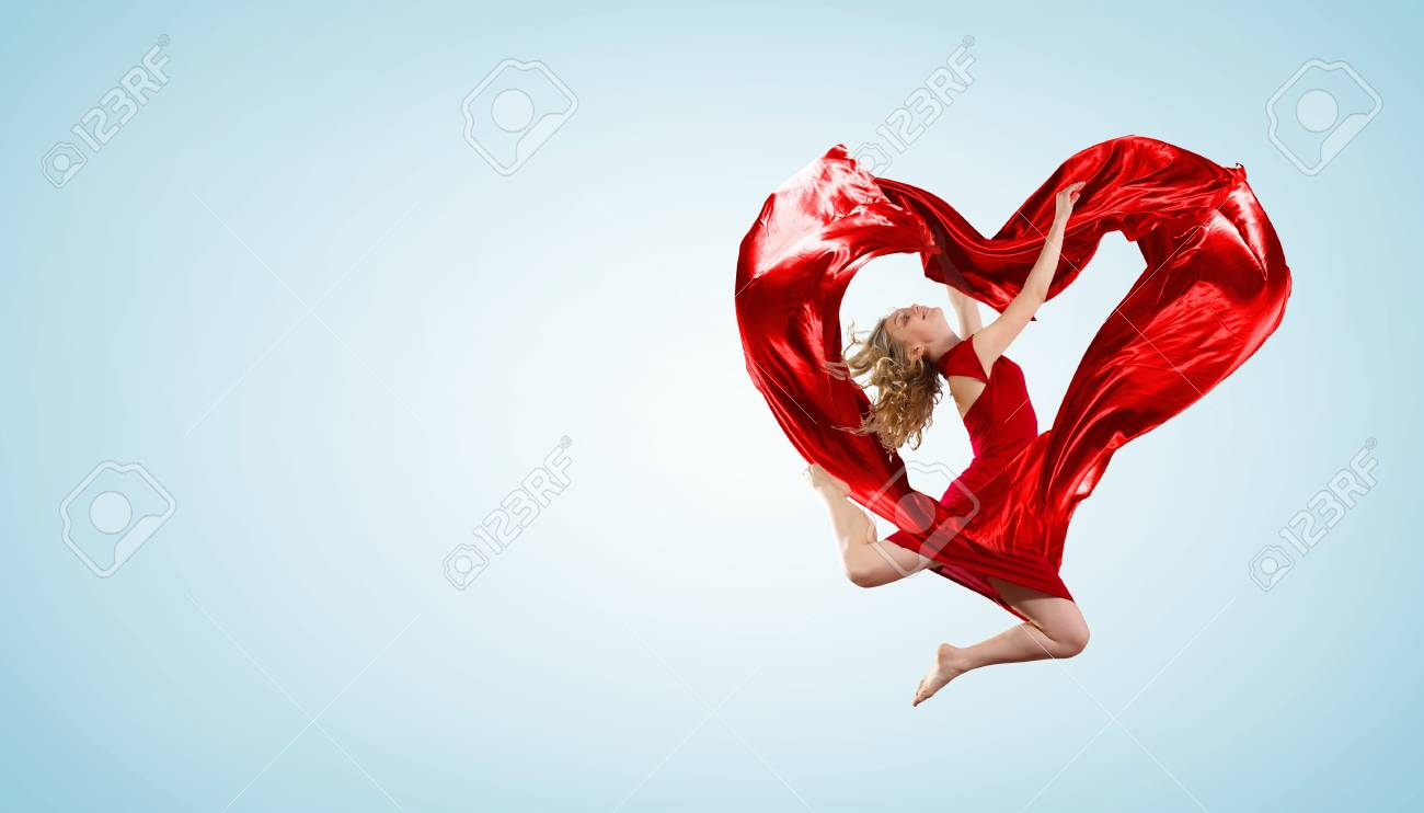 Young woman dancing with red fabric in studio and heart symbol Stock Photo - 17054822