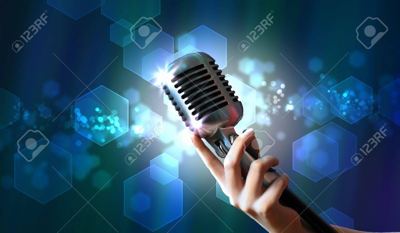 Single retro microphone against colourful background with lights Stock Photo - 17397861