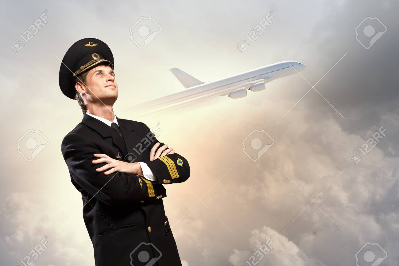 Image of male pilot with airplane at background Stock Photo - 17400043
