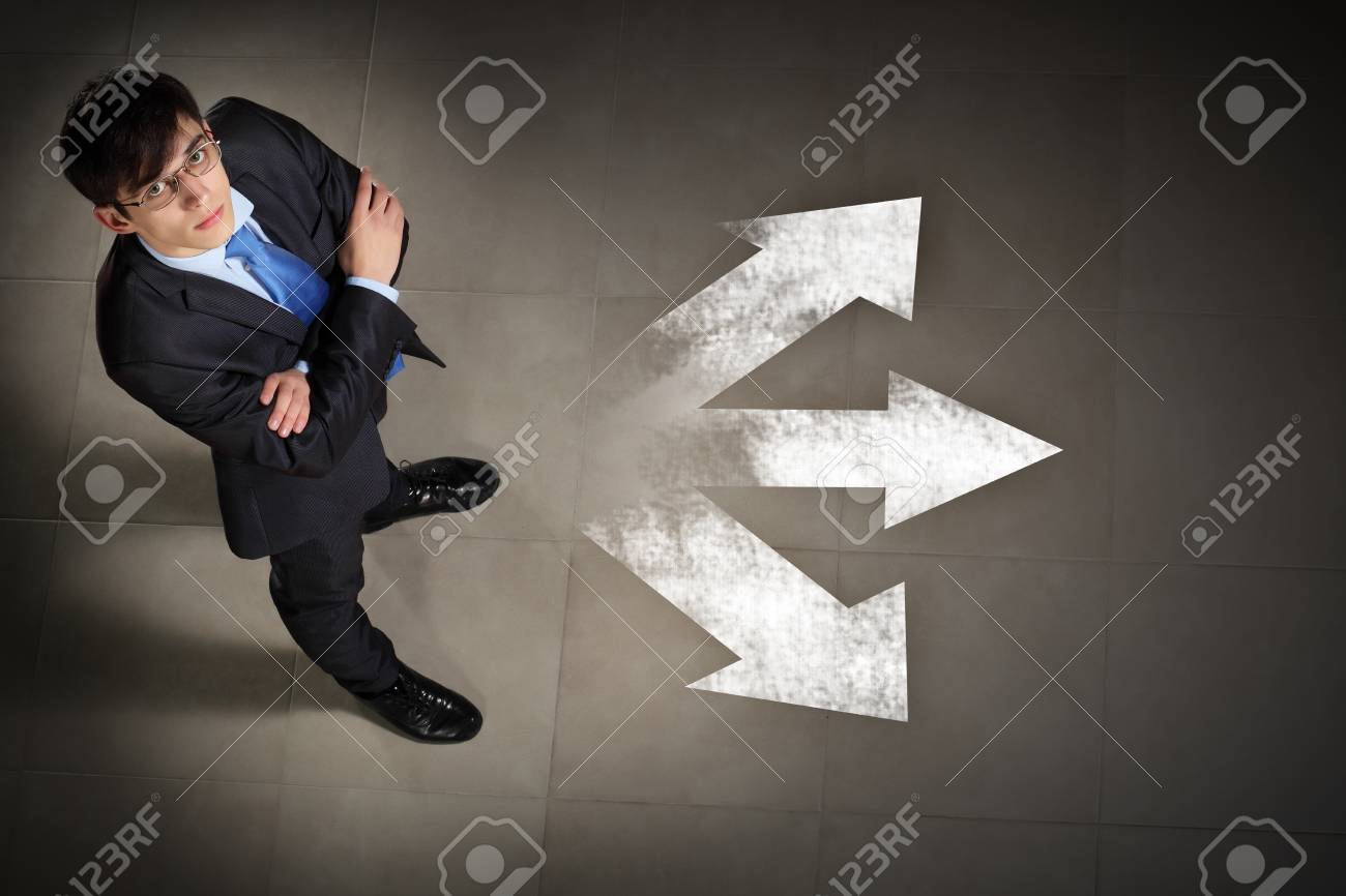Top view of businessman standing against directions background Stock Photo - 17400891