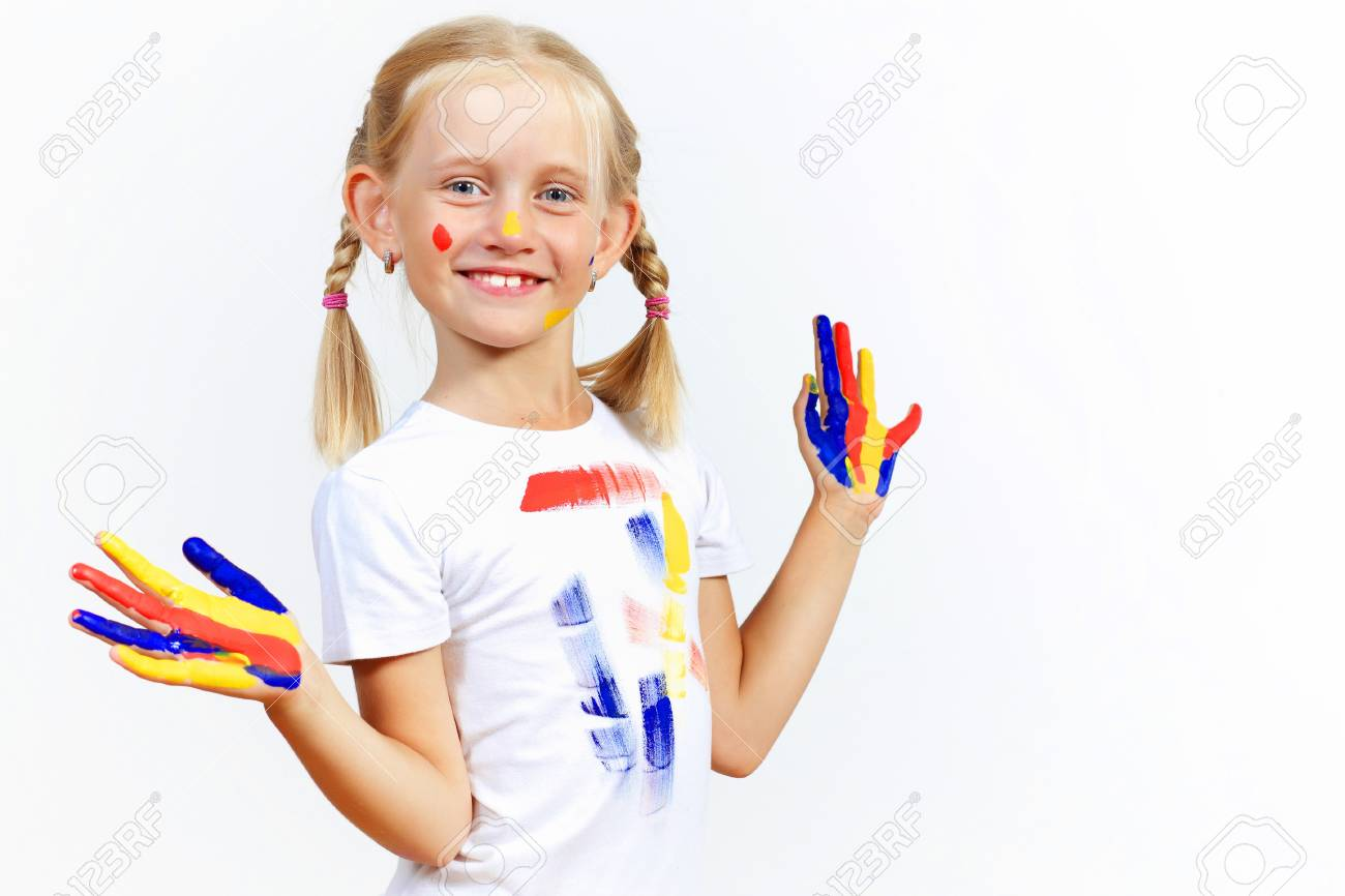 little child with hands painted in colorful paints ready for hand prints Stock Photo - 17428313