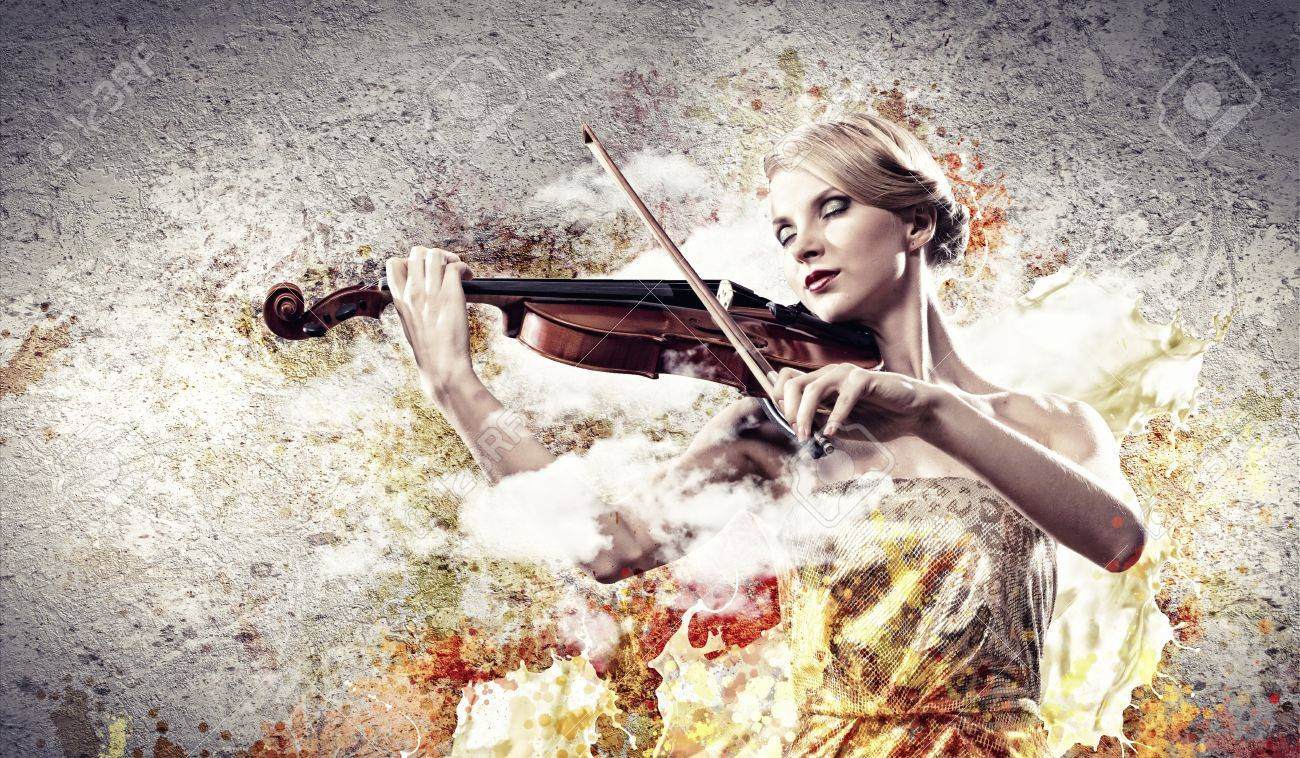 Image of beautiful female violinist playing with closed eyes against splashes background Stock Photo - 17494732
