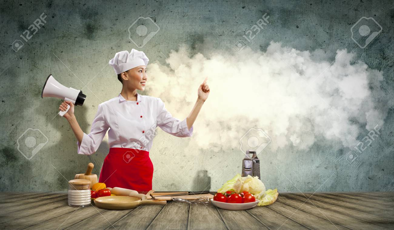 Asian female cook holding megaphone with space for text Stock Photo - 17532541