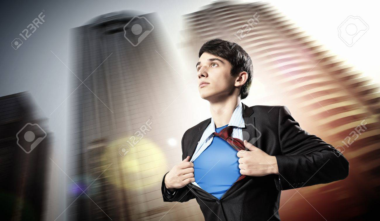 Image of young businessman showing superhero suit underneath his shirt standing against city background Stock Photo - 17531867