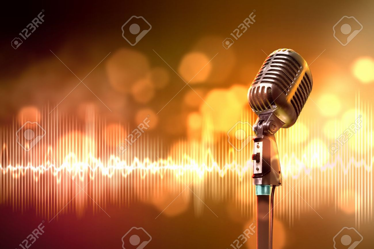 Single retro microphone against colourful background with lights - 17579170