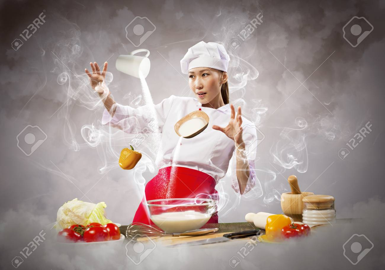 Asian female cooking with magic against color background Stock Photo - 17659342
