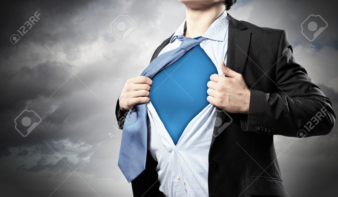 Image of young businessman showing superhero suit underneath his shirt Standard-Bild - 17760447