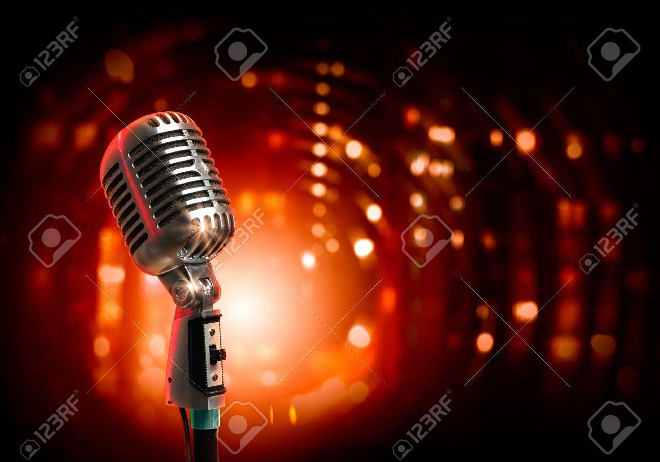Single retro microphone against colourful background with lights - 17769574