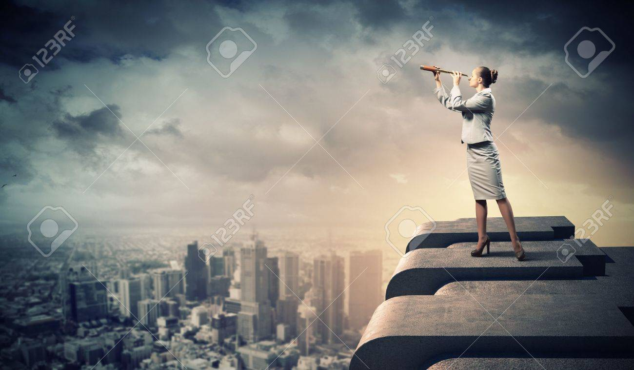 Image of businesswoman looking in telescope standing a top of building Stock Photo - 18020942