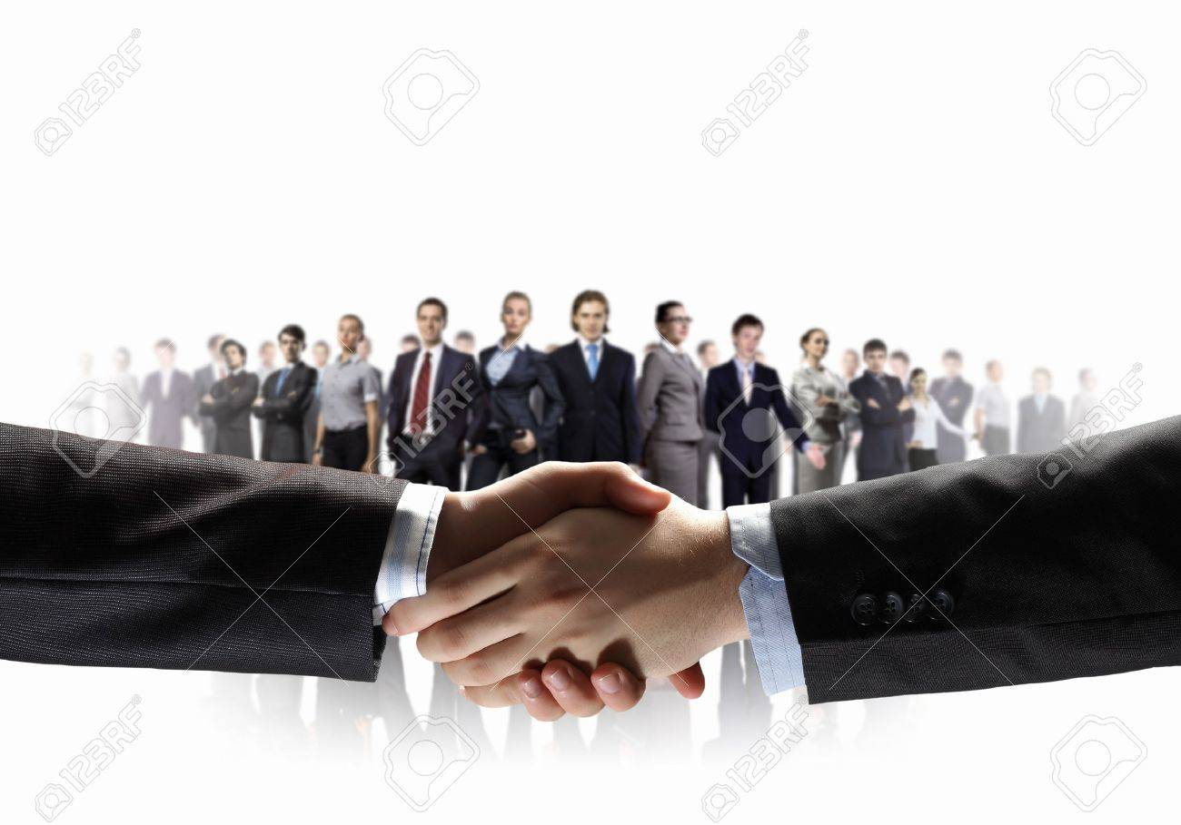 business handshake against white background and standing businesspeople Stock Photo - 18020984