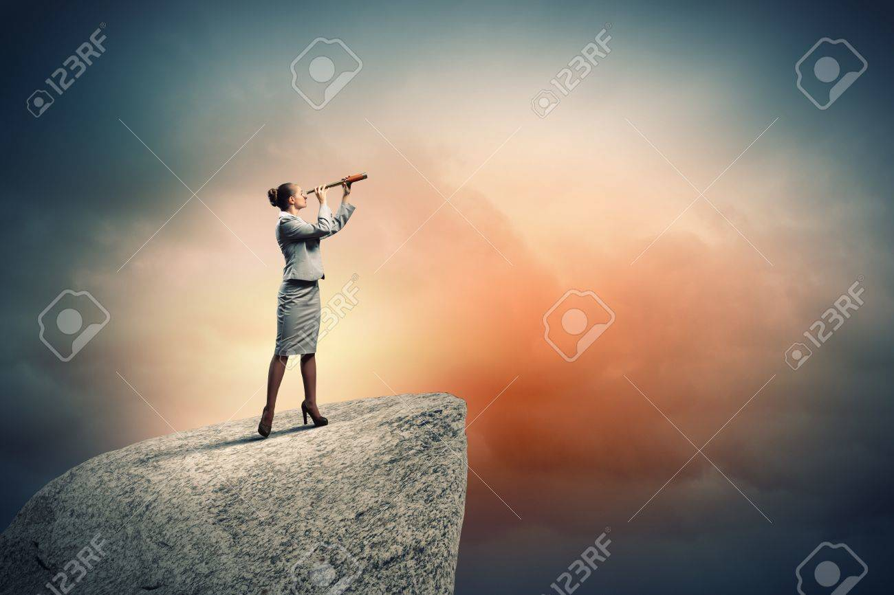 Image of businesswoman looking in telescope standing atop of rock Stock Photo - 18021143