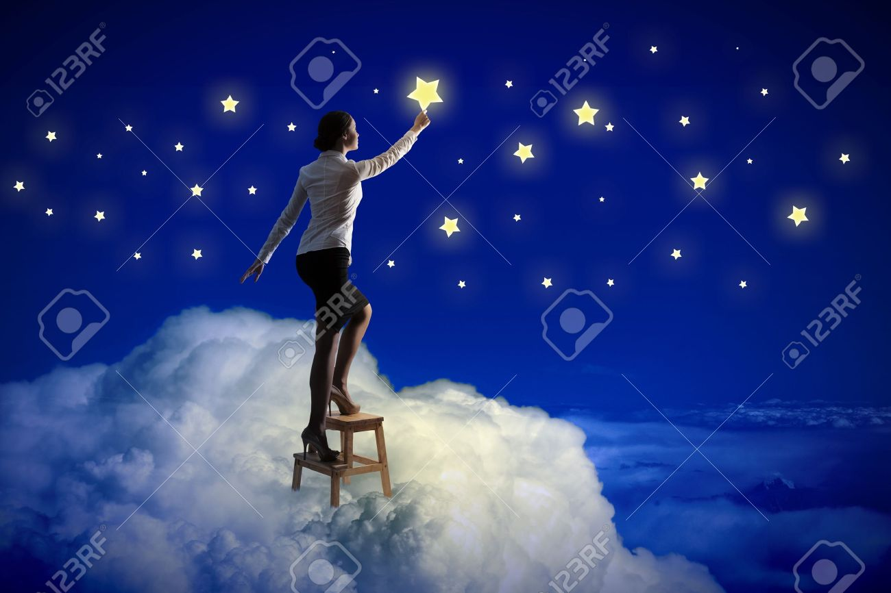 Image of young woman lighting stars in night sky Stock Photo - 20024500