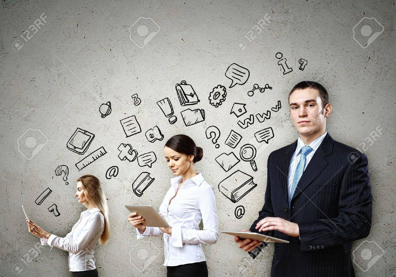 Three young people in business suits with tablet pc in hands Stock Photo - 20107720