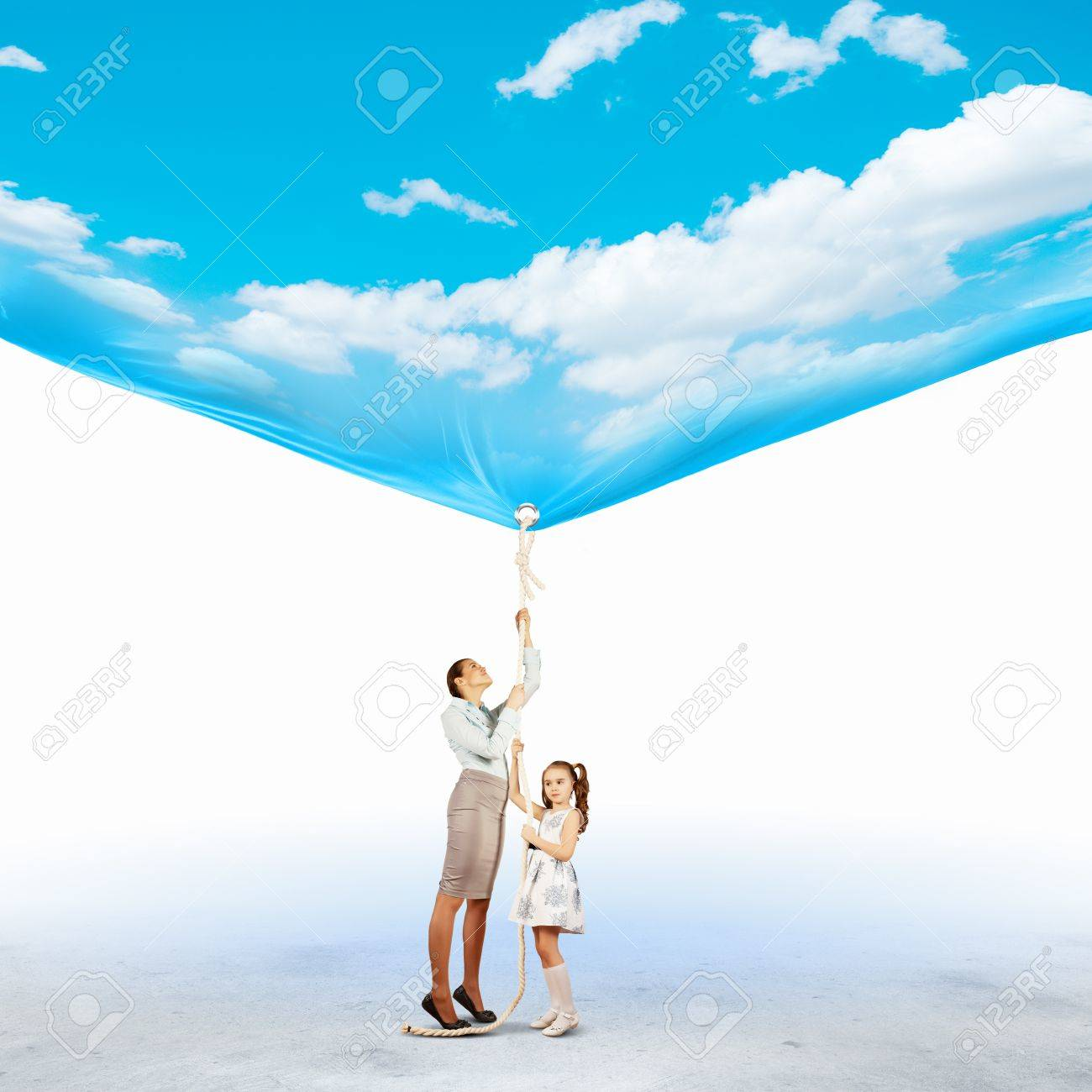 Image of young happy family pulling banner with night illustration Stock Photo - 20085994