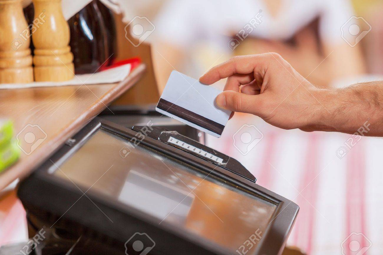 Close-up image of cashier male hands holding card Stock Photo - 20207694