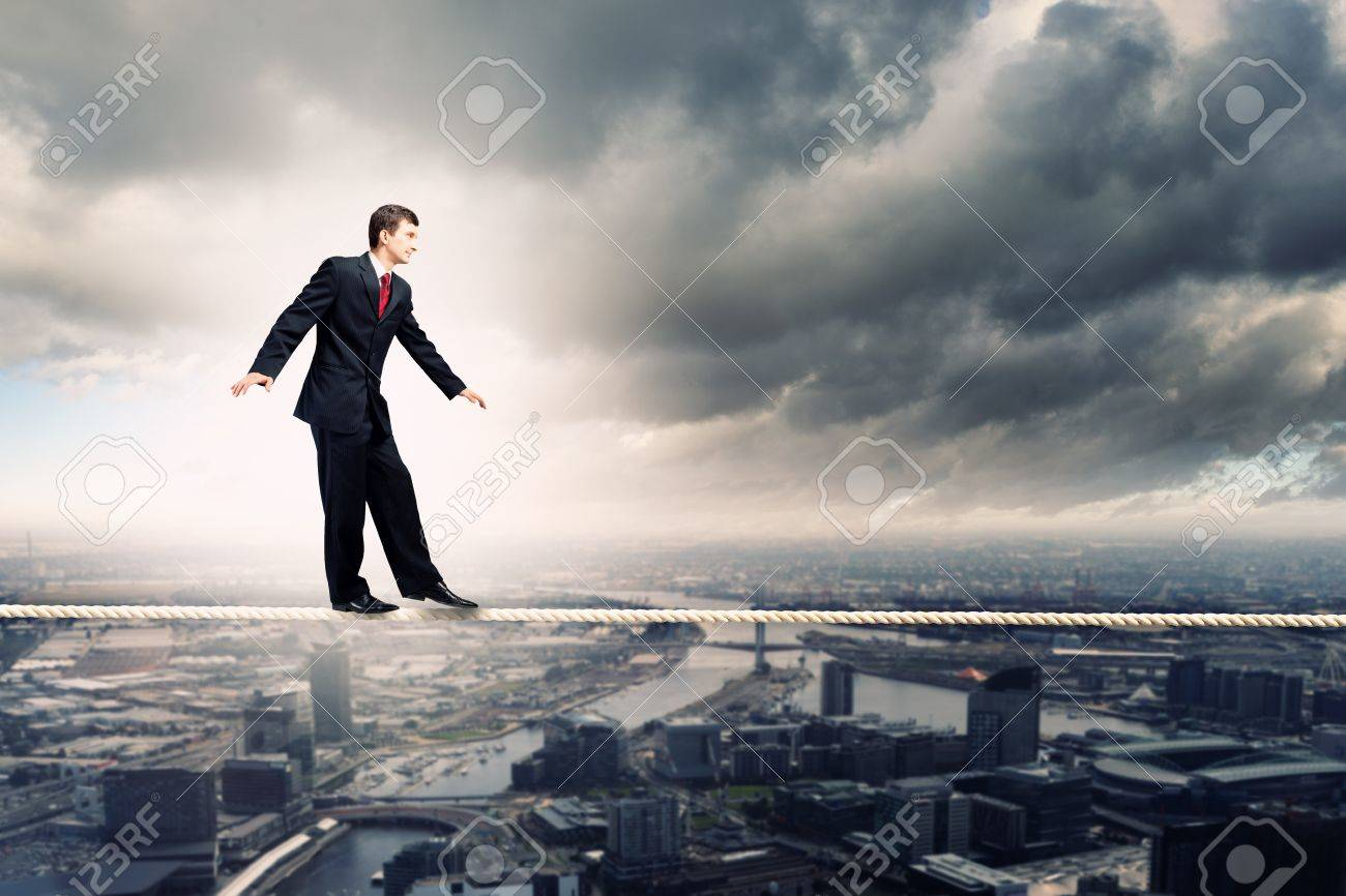 Image of pretty businessman balancing on rope Stock Photo - 20327171