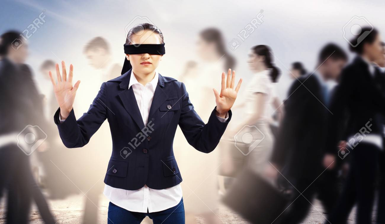 Image of businesswoman in blindfold walking among group of people Stock Photo - 20327310