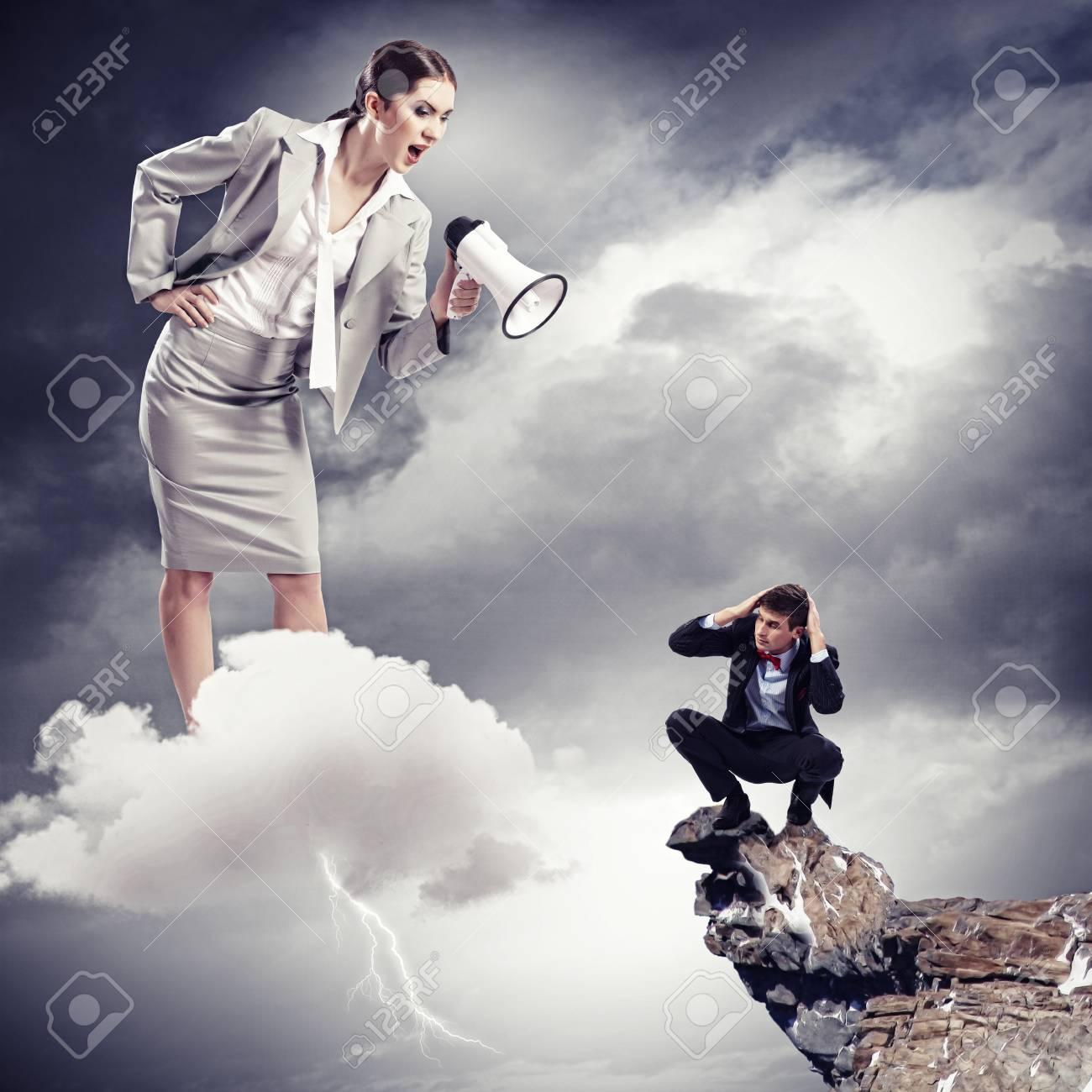 Angry businesswoman with megaphone shouting at colleague Stock Photo - 20327506