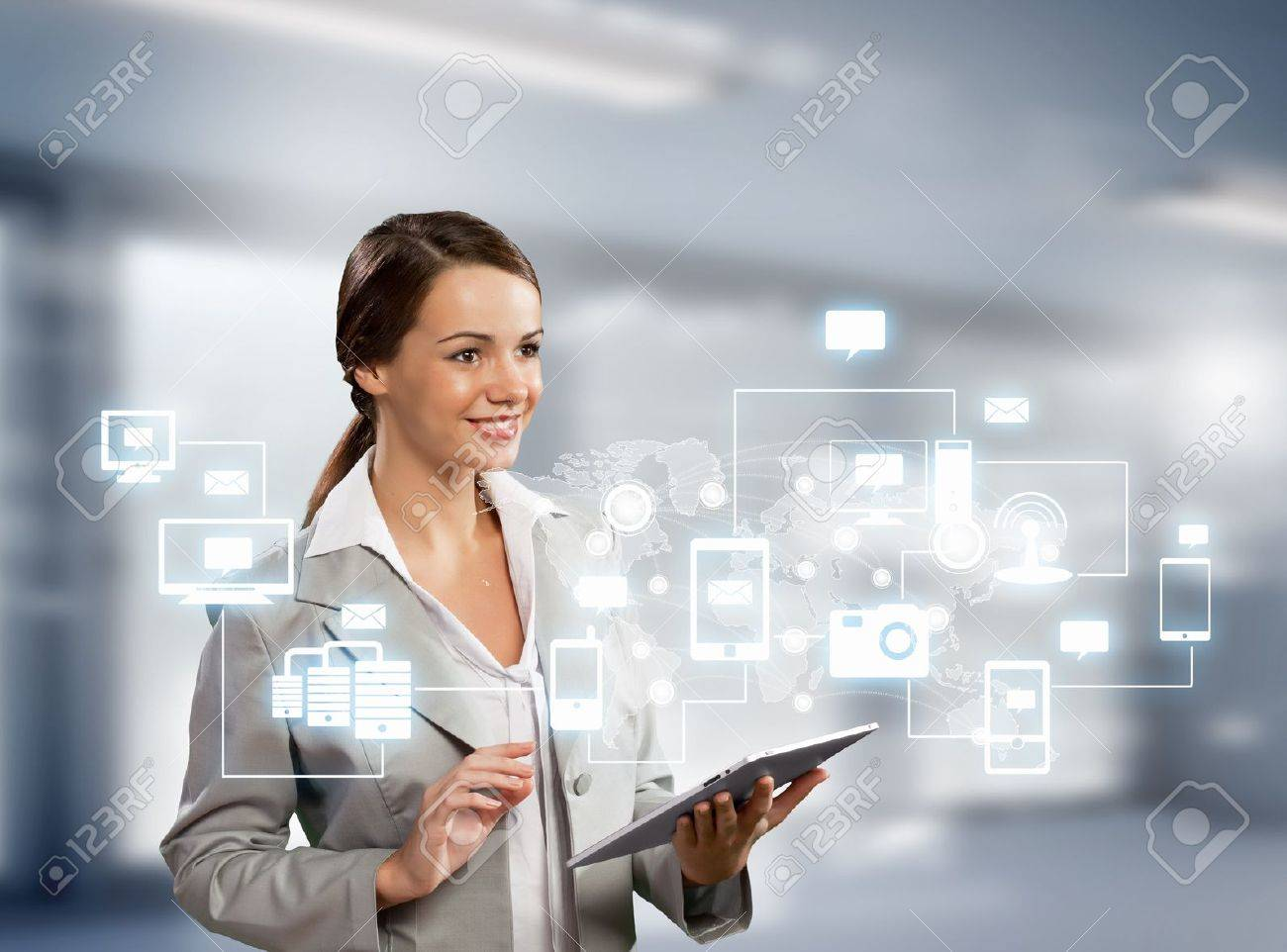 Image of businesswoman with tablet pc against high-tech background Stock Photo - 20327170