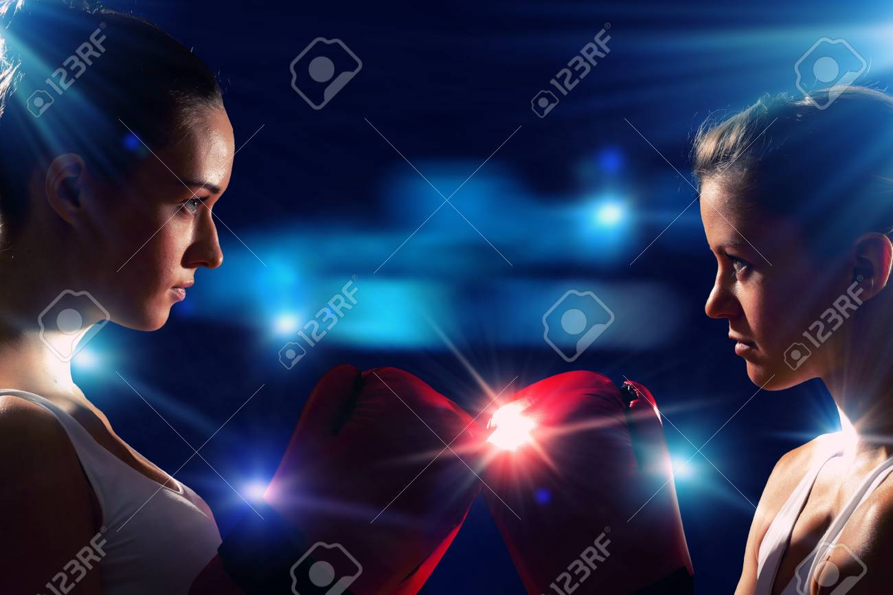4c6ed0626 Two boxer women in gloves greet each other before fight Stock Photo -  20560104
