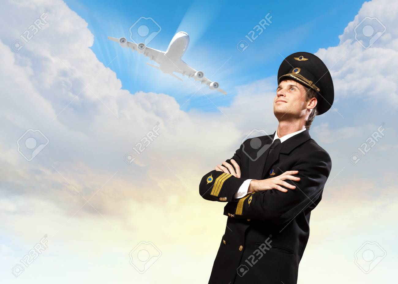 Image of male pilot with airplane at background Stock Photo - 20559870