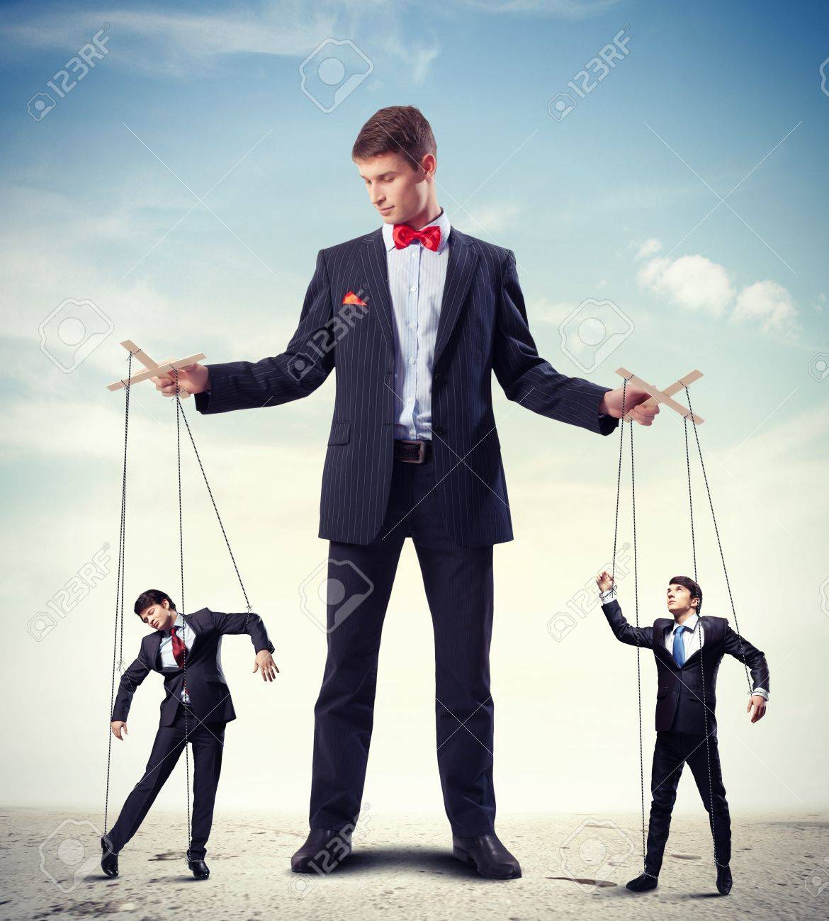 Image of young businessman puppeteer  Leadership concept Stock Photo - 20661872