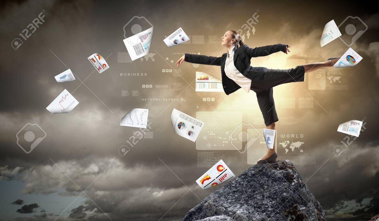 young businesswoman standing on one leg atop of mountain against diagram background Stock Photo - 20661876