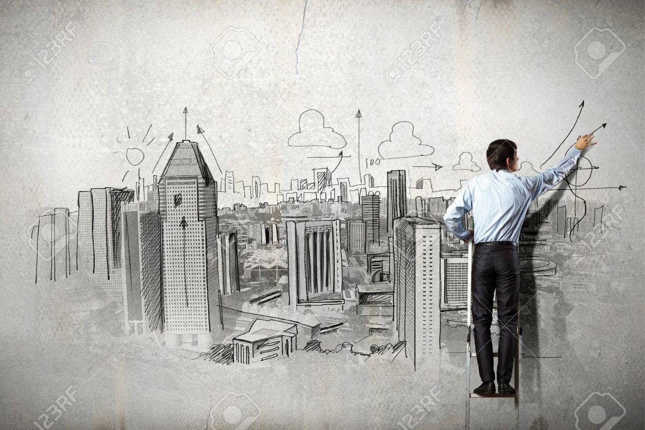 Back view of businessman drawing sketch on wall Stock Photo - 21247038