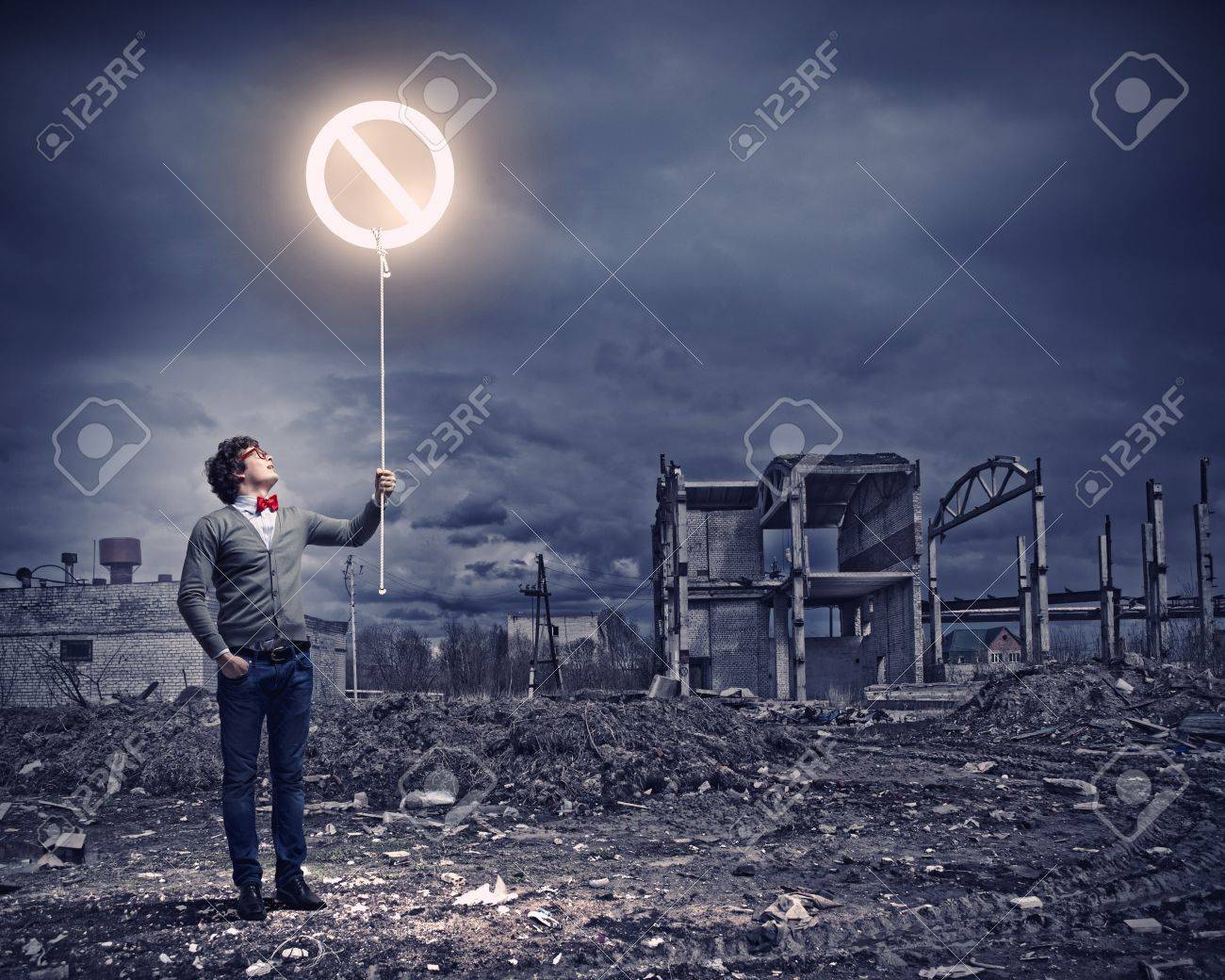 Young man and stop sign against polluted and ruined landscape Stock Photo - 21247189