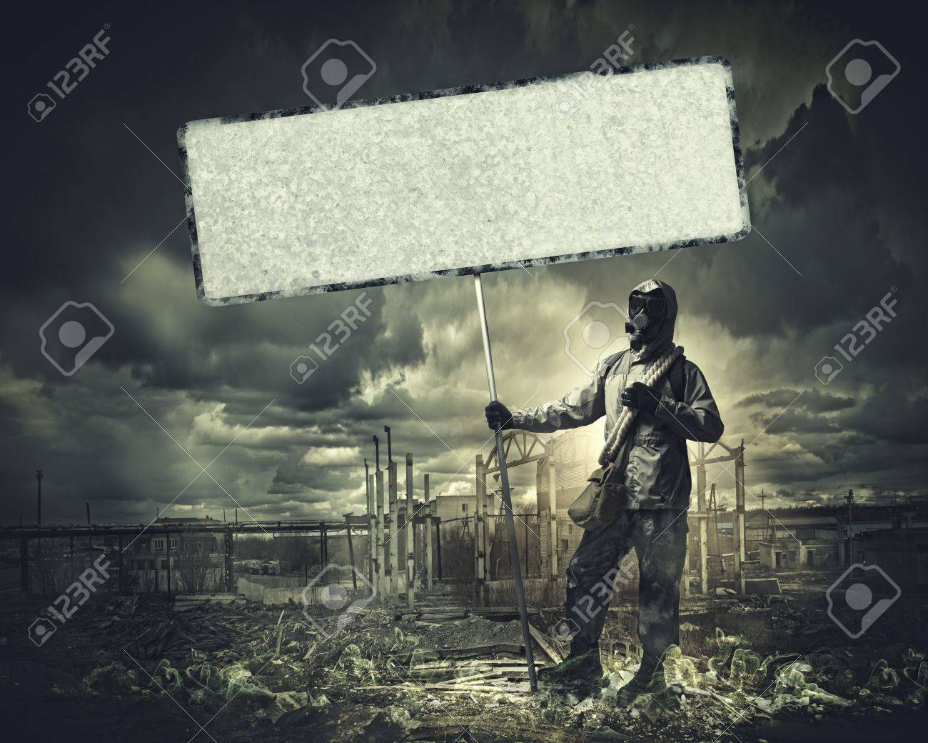 Stalker in gas mask with blank banner  Disaster concept Stock Photo - 21388902