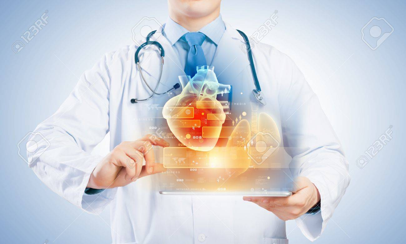 Close-up of doctor s body with tablet pc in hands - 21449200
