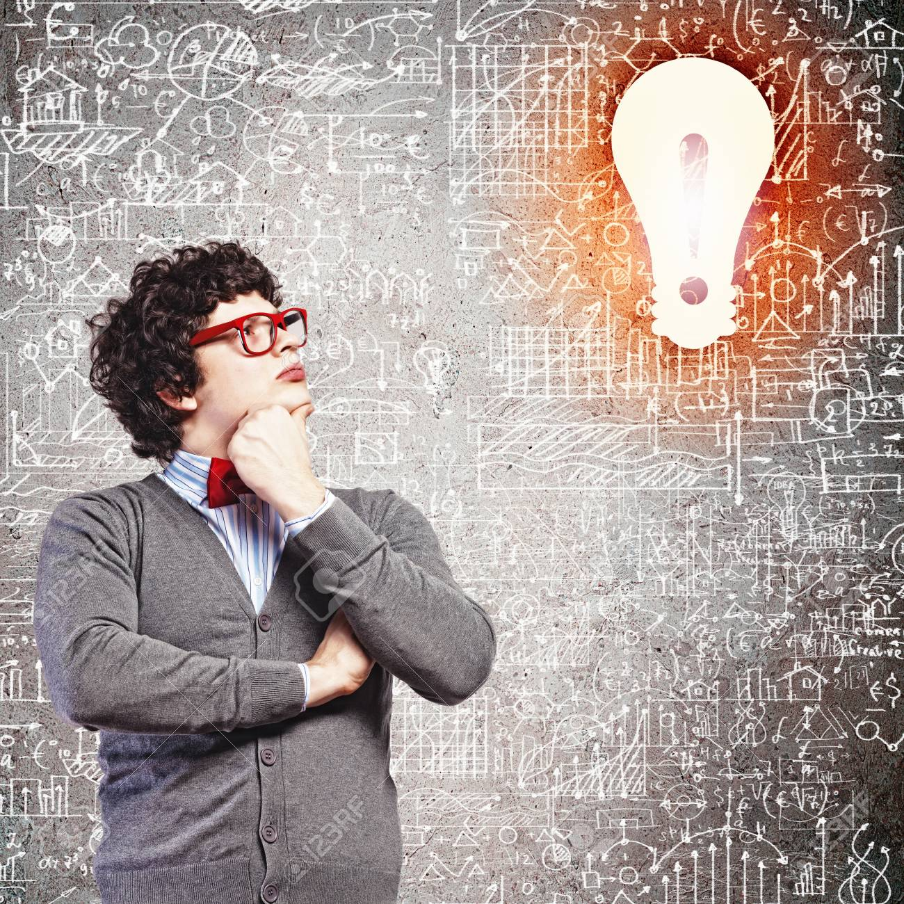 Young man in the process of thinking and finding a solution Stock Photo - 21481165