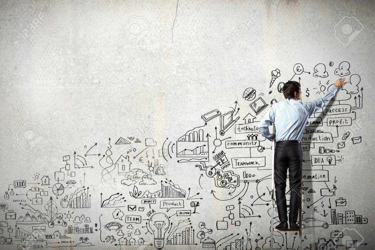 Back view of businessman drawing sketch on wall - 21532095