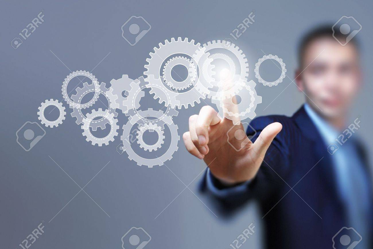 Image of businessman touching gear elements  Mechanism concept Stock Photo - 21643957