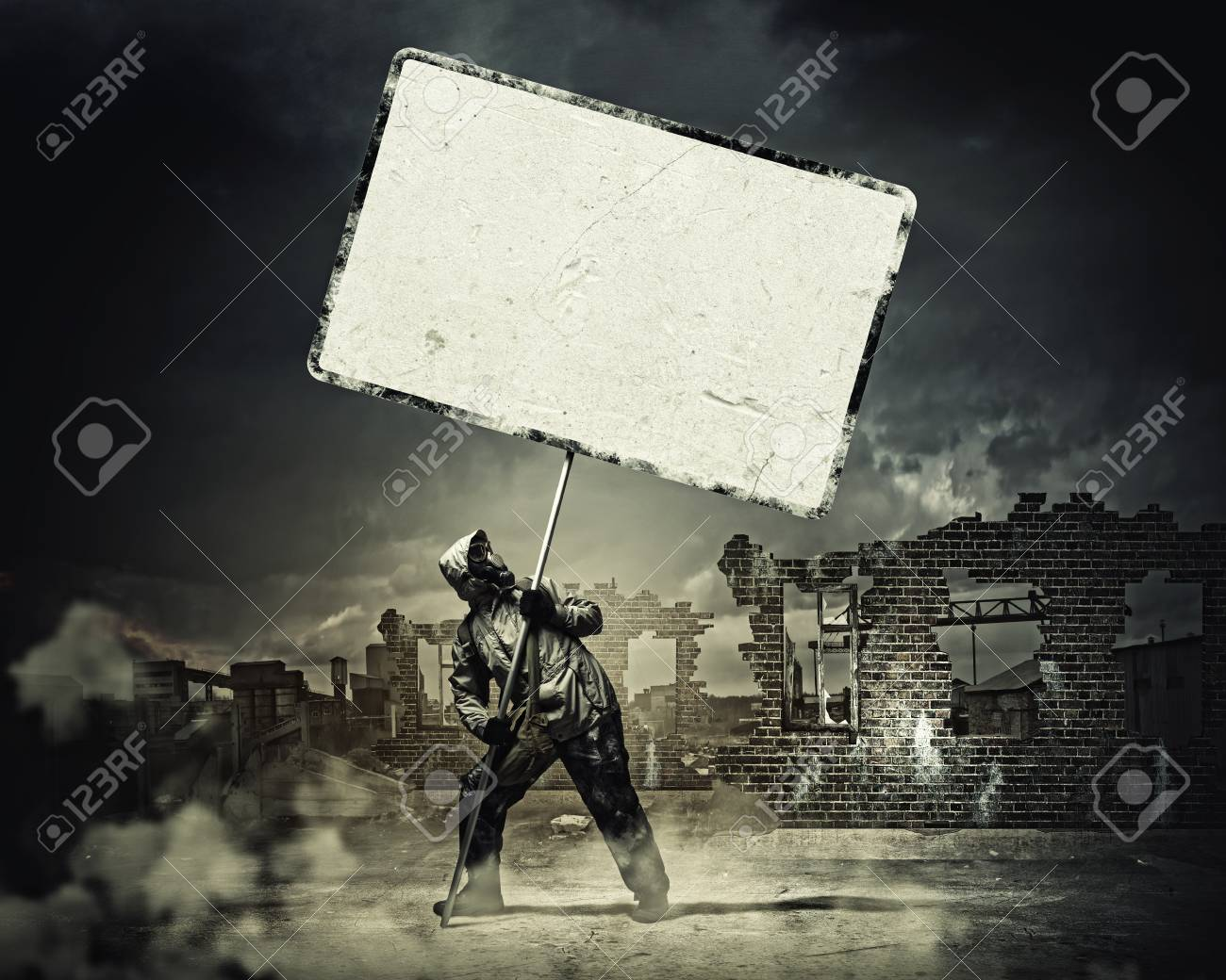 Stalker in gas mask with blank banner  Disaster concept Stock Photo - 21789402