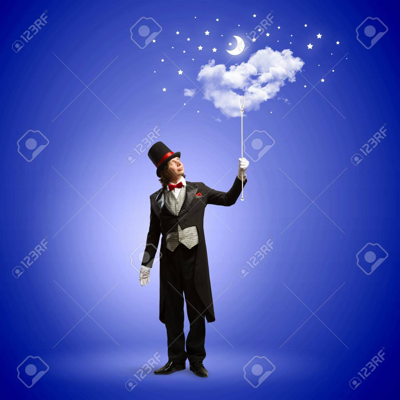 Image of man magician against color background Stock Photo - 22040104