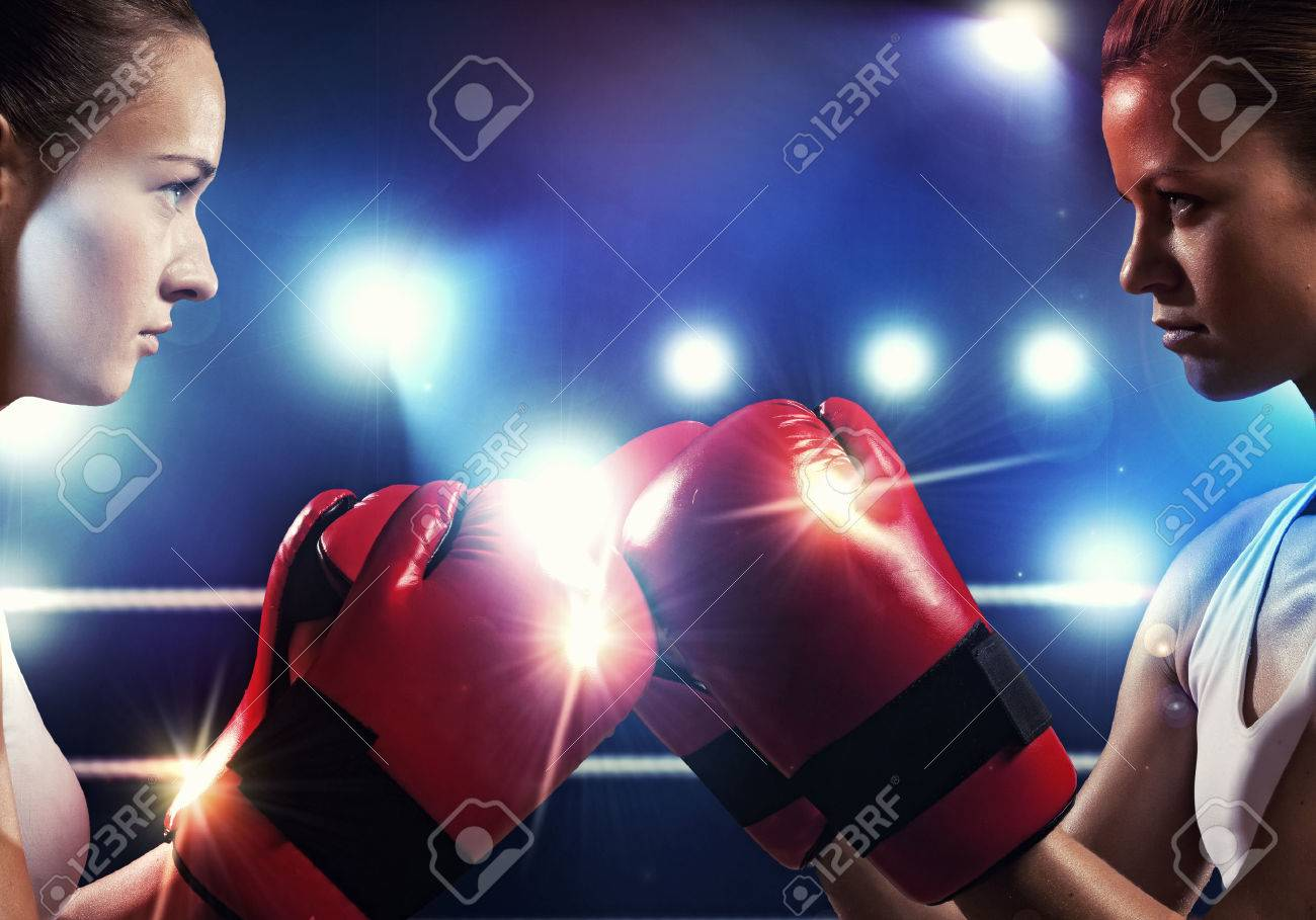1146abf84 Two boxer women in gloves greet each other before fight Stock Photo -  24424549
