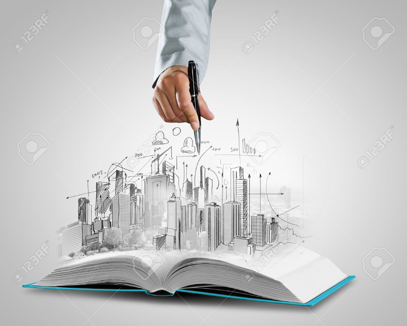 Opened book and hand drawing building sketches Stock Photo - 24504261