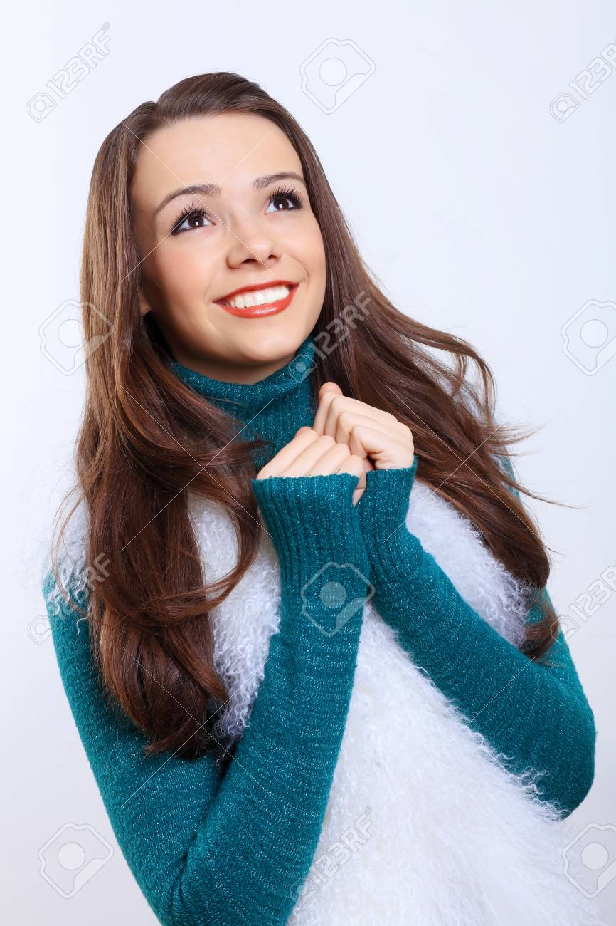 Young pretty woman with long hair wearing warm pullover Stock Photo - 25575343
